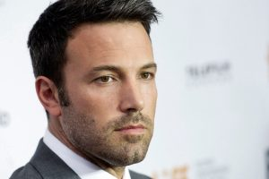 "Actor and director Ben Affleck poses for a photograph on the red carpet at the gala for the new movie ""Argo"" during the 37th annual Toronto International Film Festival in Toronto on Friday, Sept. 7, 2012. (AP Photo/The Canadian Press, Nathan Denette)"