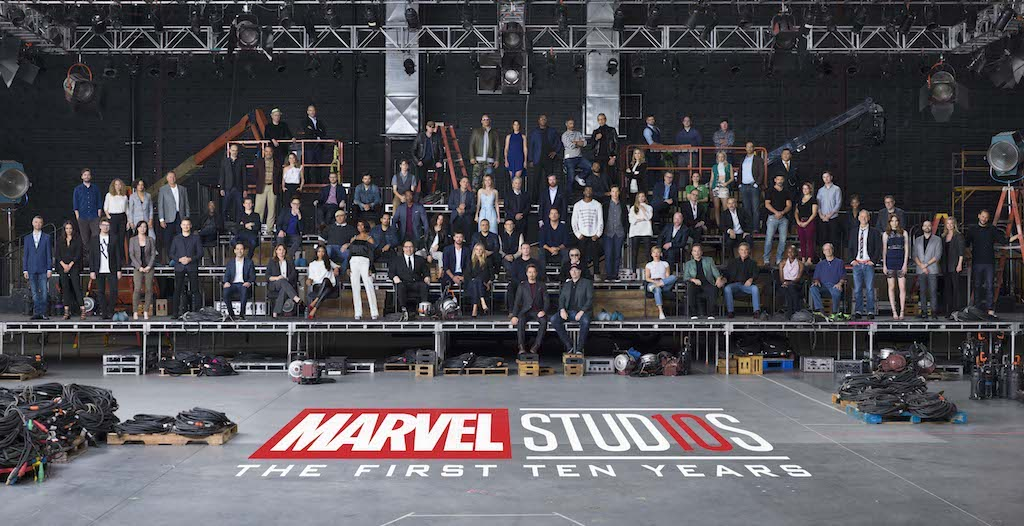 "Marvel Studios ""The First Ten Years"" Class Photo  Front Row L to R: Sean Gunn (Kraglin), Hannah John-Kamen (Ghost), Director Scott Derrickson, Executive Producer Trinh Tran, Jeremy Renner (Hawkeye), Paul Rudd (Ant-Man), EVP, Physical Production Victoria Alonso, Zoe Saldana (Gamora), Angela Bassett (Ramonda), Director/Actor Jon Favreau (Happy Hogan), Chris Hemsworth (Thor), Gwyneth Paltrow (Pepper Potts), Chris Evans (Captain America), Robert Downey Jr. (Iron Man), Executive Producer/Writer Stan Lee, President of Marvel Studios Kevin Feige, Scarlett Johansson (Black Widow), Co-President of Marvel Studios Louis D'Esposito, Kurt Russell (Ego), Danai Gurira (Okoye), William Hurt (Thaddeus Ross), Director Alan Taylor, Karen Gillan (Nebula), Executive Producer Brad Winderbaum, Emily VanCamp (Sharon Carter), Director Louis Letterier   Second Row L to R: Director Jon Watts, Casting Director Sarah Finn, Tessa Thompson (Valkyrie), VP, Physical Production David Grant, Don Cheadle (War Machine), Tom Holland (Spider-Man), Director James Gunn, Dave Bautista (Drax), Michael Peña (Luis), Anthony Mackie (Falcon), Evangeline Lilly (Wasp), Director Joe Russo, Director Anthony Russo, Chris Pratt (Star-Lord), Chadwick Boseman (Black Panther), Benedict Cumberbatch (Doctor Strange), Elizabeth Olsen (Scarlet Witch), Director Joss Whedon, Paul Bettany (Vision), VP, Physical Production Mitchell Bell, Frank Grillo (Crossbones), Director Anna Boden, Director Ryan Fleck, Letitia Wright (Shuri), Editor Jeffrey Ford  Third Row L to R: Director Peyton Reed, Laurence Fishburne (Dr. Bill Foster), Linda Cardellini (Laura Barton), Executive Producer Jonathan Schwartz, Sebastian Stan (Winter Soldier), Ty Simpkins (Harley Keener), Mark Ruffalo (Hulk), Brie Larson (Captain Marvel), Michael Douglas (Hank Pym), Executive Producer Stephen Broussard, Director Ryan Coogler, Michelle Pfeiffer (Janet van Dyne), Executive Producer Jeremy Latcham, Hayley Atwell (Peggy Carter), Pom Klementieff (Mantis), Executive Producer Nate Moore, Benedict Wong (Wong)  Fourth Row L to R: Screenwriter Christopher Markus, Screenwriter Stephen McFeely, Michael Rooker (Yondu), Vin Diesel (Groot), Cobie Smulders (Maria Hill), Samuel L. Jackson (Nick Fury), Director Taika Waititi, Jeff Goldblum (Grandmaster), Executive Producer Erik Carroll, Head of Visual Development Ryan Meinerding, Executive Producer/Screenwriter Craig Kyle   Photo Credit: Marco Grob  ©Marvel Studios 2018"